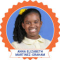 Photo of young Black girl smiling in school clothing