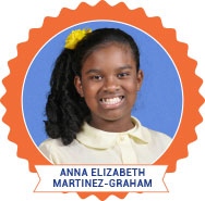 Anna Elizabeth Martinez-Graham Photo of young Black girl smiling in school clothing