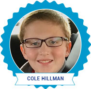 Cole Hillman, winner. Young boy wearing glasses smiling