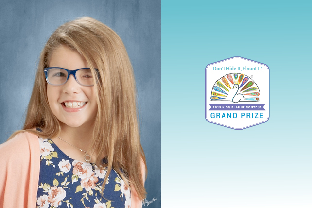 Young girl with glasses smiling proudly alongside her winner badge