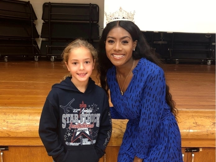 Miss America with student smiling for school event with Don't HIde it Flaunt it.